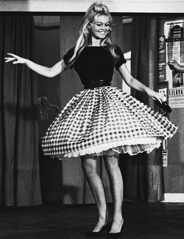 "05 Aug 1959, Nice, France --- 8/5/1959-Nice, France- Displaying a shapely set of gams, French ""sex-kitten"" Brigitte Bardot does the cha-cha under the direction of comic Darius Moreno. ""B.B."" appears in a new movie called ""Will You Dance With Me?"" (silly question) in which Moreno plays the part of a dancing teacher. --- Image by © Bettmann/CORBIS"